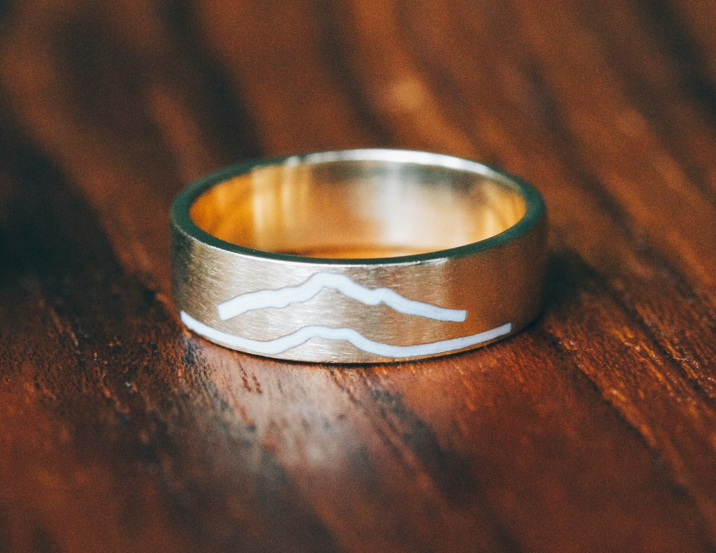 mountain inspired ring with white enamel