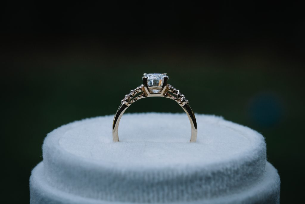 Oval Center Stone Set In A 4 Prong Basket Setting.