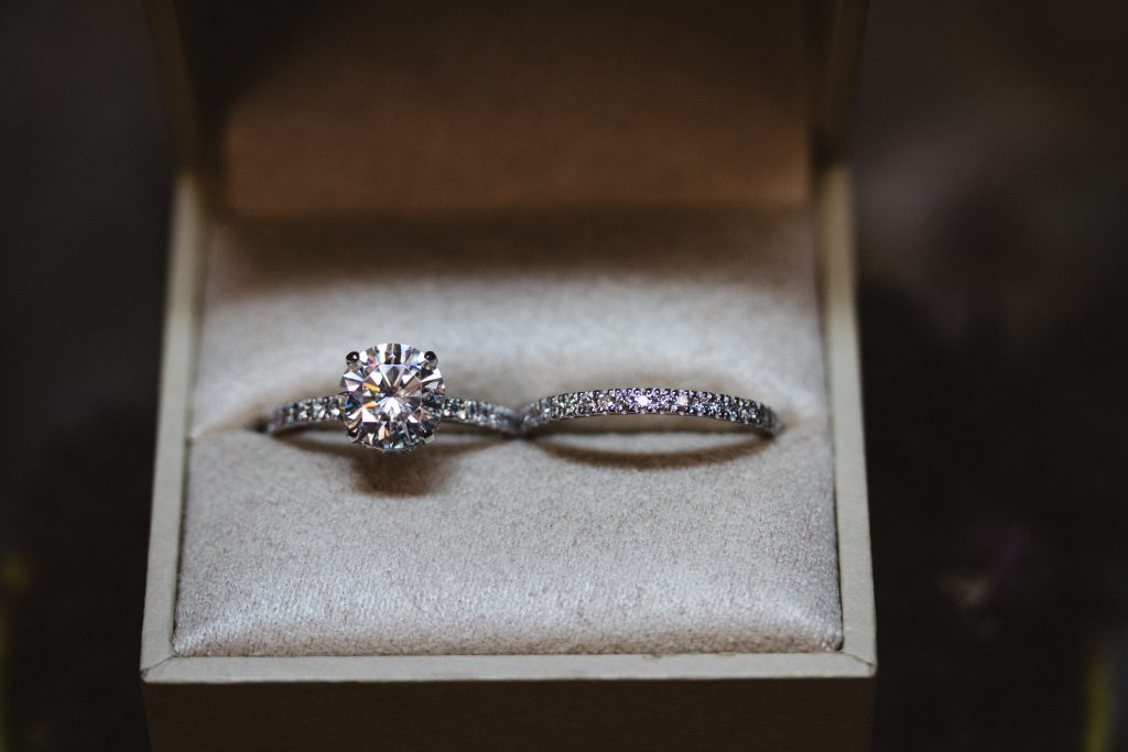 Custom platinum wedding set. Invisible gallery engagement ring with custom wedding band to match.