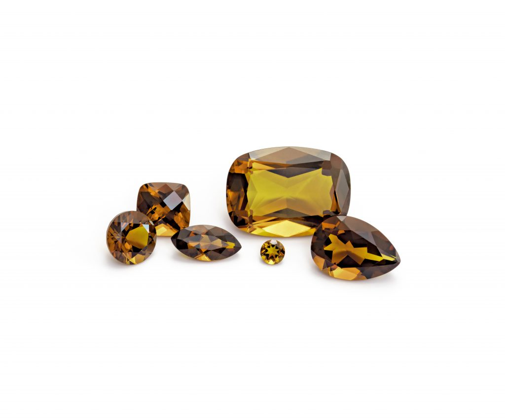 6 loose citrine gemstones. An antique square, pear, round, and marquise shape.