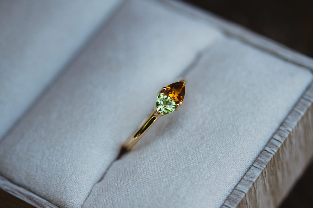 Custom trillion birthstone ring with a thin yellow gold band