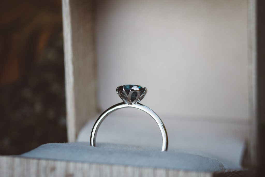an engagement ring with a tulip head