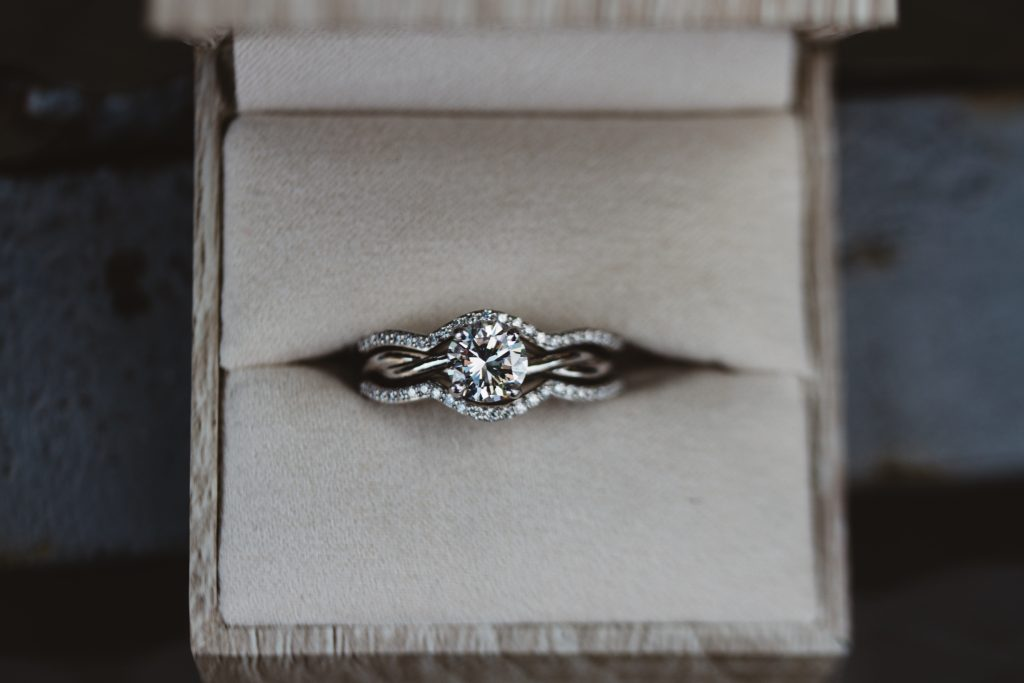 Engagement ring with ring enhancer