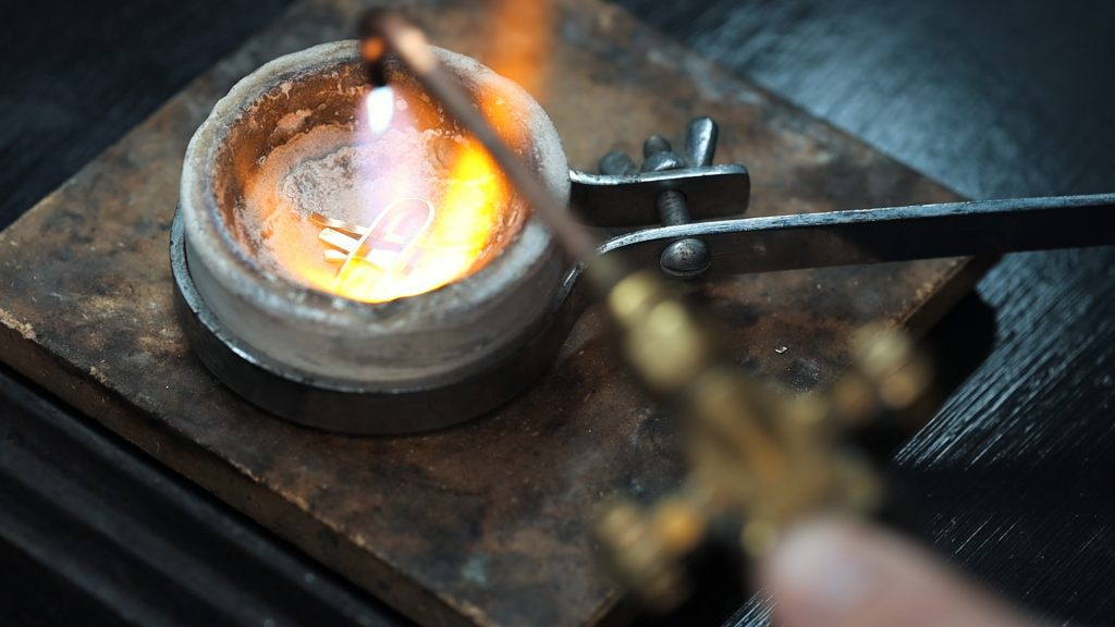 Melting gold in a crucible